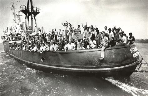 Cuban refugees arriving in crowded boats during the Mariel
