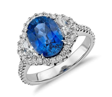 Blue Sapphire and Diamond Halo Three-Stone Ring in 18k