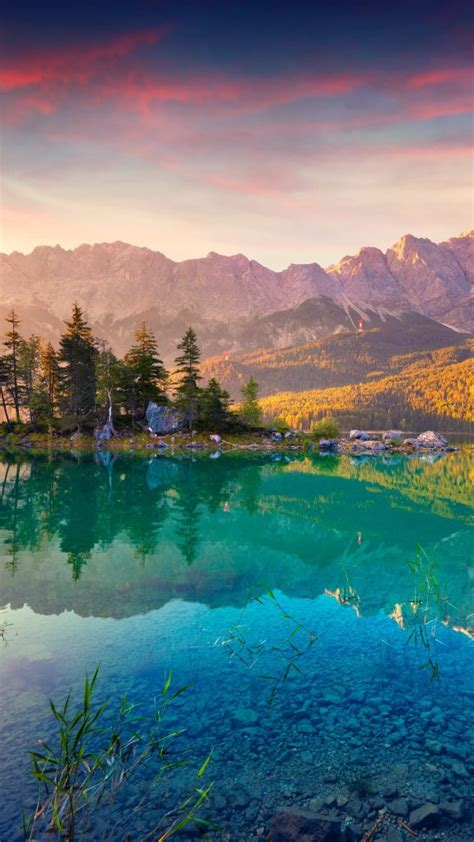 Summer sunrise on the Eibsee lake in German Alps, Germany